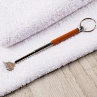 Мини-чесалка с раздвижной ручкой
